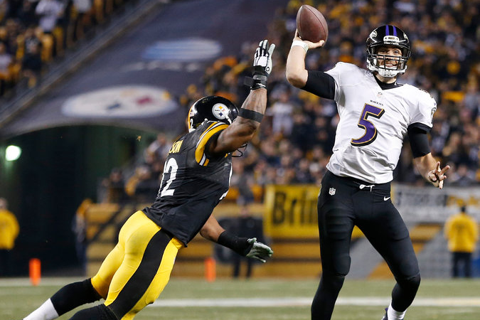 Joe Flacco evades a James Harrison sack in no huddle offense for a touchdown