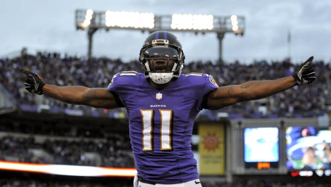 Kamar Aiken scores a touchdown against the Browns, dances in the end zone