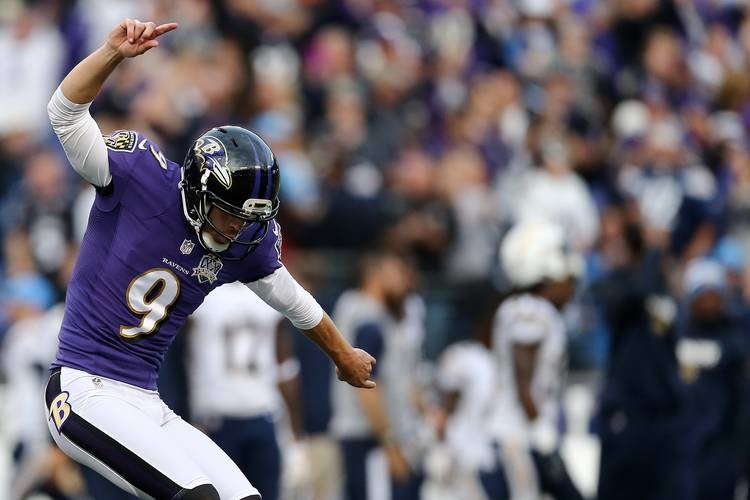 Justin Tucker points to the ground and up in the air as he does the Hotline Bling Drake dance