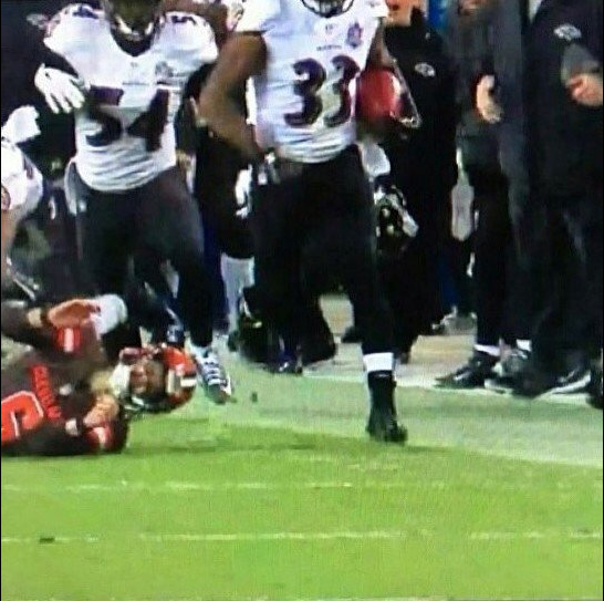 Will Hill appears out of bounds as he runs down the sideline on his game-winning return.