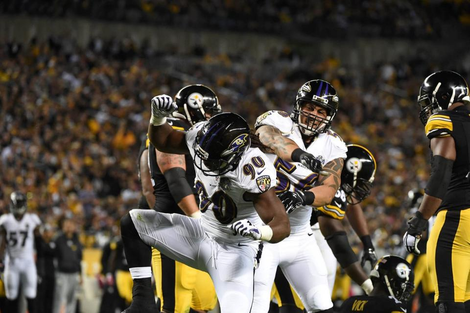 Baltimore Ravens LB Za'Darius Smith (90) celebrates a sack of Steelers QB Michael Vick in Baltimore's 23-20 victory over Pittsburgh in overtime.