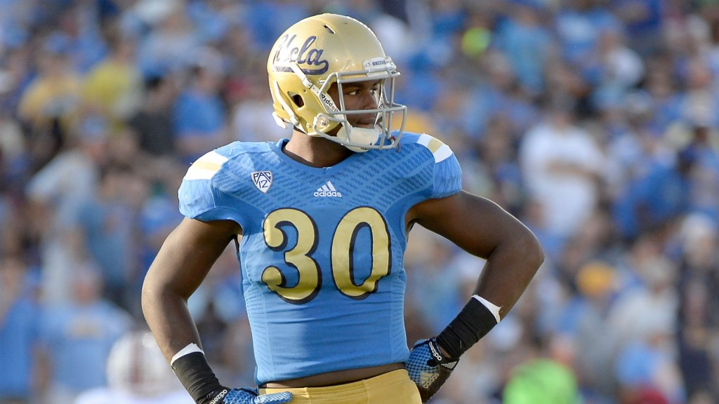 Notre Dame LB Myles Jack in his blue UCLA jersey with his hands on his hips.