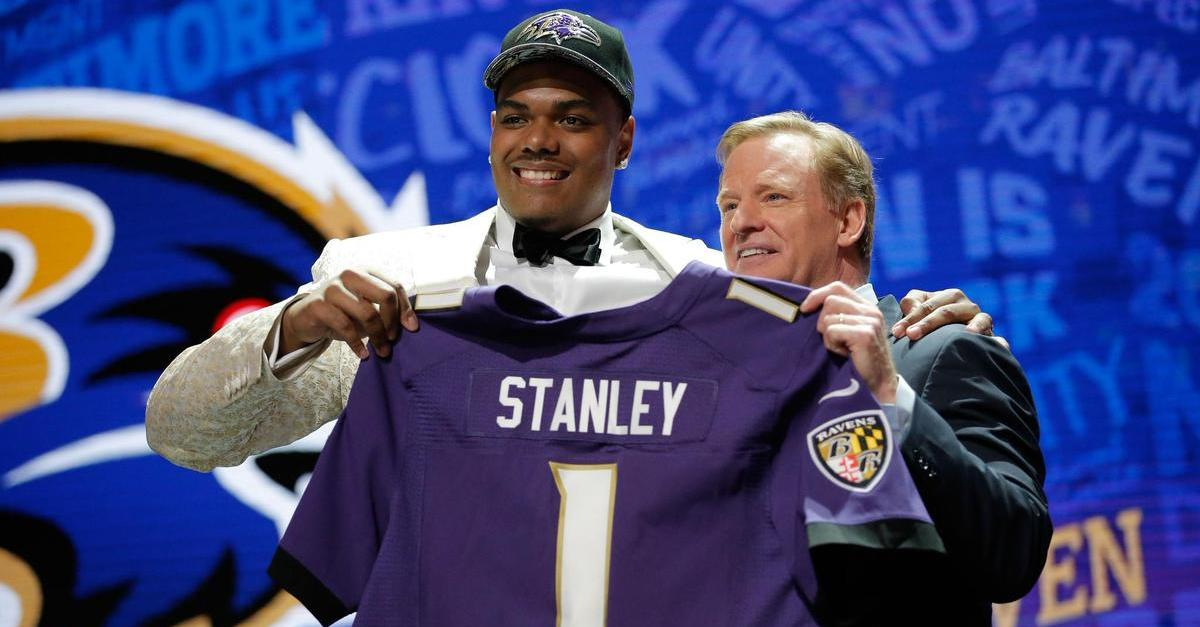 Ravens OT Ronnie Stanley proudly showing off his new jersey at the NFL Draft with Roger Goodell.