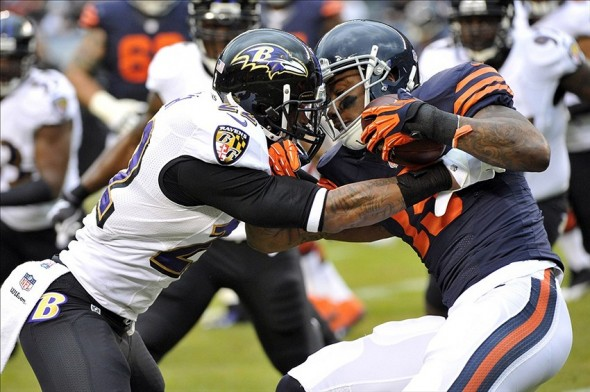 Ravens CB Jimmy Smith tackles Bears WR Brandon Marshall in 2013.