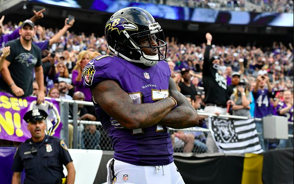 Ravens Hang On, Claim First Place