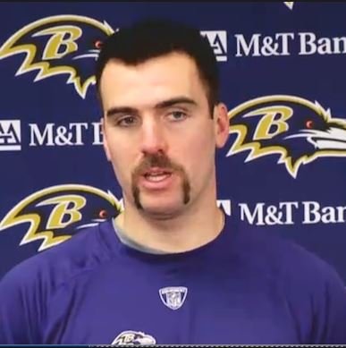 Joe Flacco sports a Fu Manchu mustache.