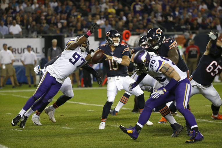 Minnesota Vikings defensive end Everson Griffen (97) strips the ball from Chicago Bears quarterback Mitchell Trubisky (10) during the first half of an NFL football game, Monday, Oct. 9, 2017, in Chicago. (AP Photo/Charles Rex Arbogast) ORG XMIT: CXB1
