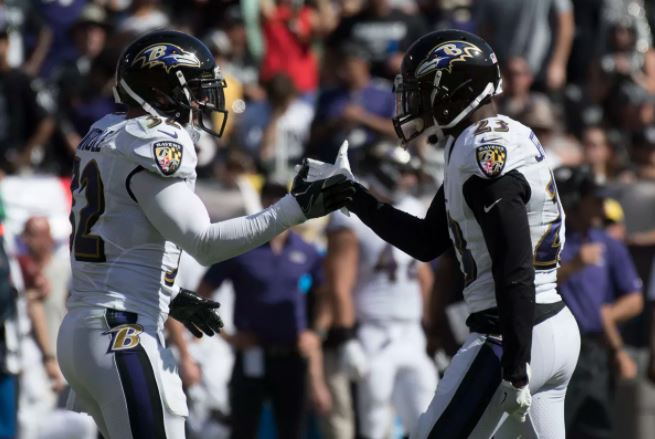 Baltimore Ravens safeties Eric Weddle and Tony Jeffferson give each other five in Oakland.