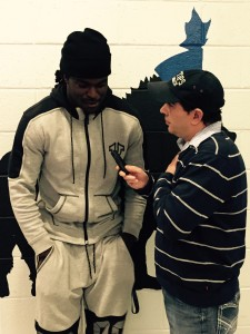 Brian Bower interviews Breshad Perriman at a holiday event.