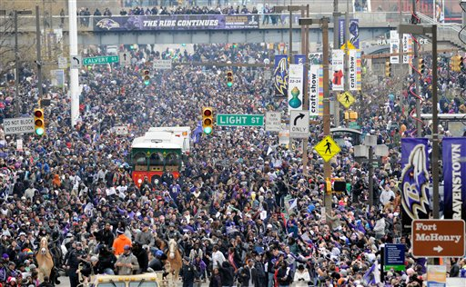 Baltimore Ravens fans fill the streets during a victory parade Tuesday, Feb. 5, 2013, in Baltimore. The Ravens defeated the San Francisco 49ers in NFL football's Super Bowl XLVII 34-31.