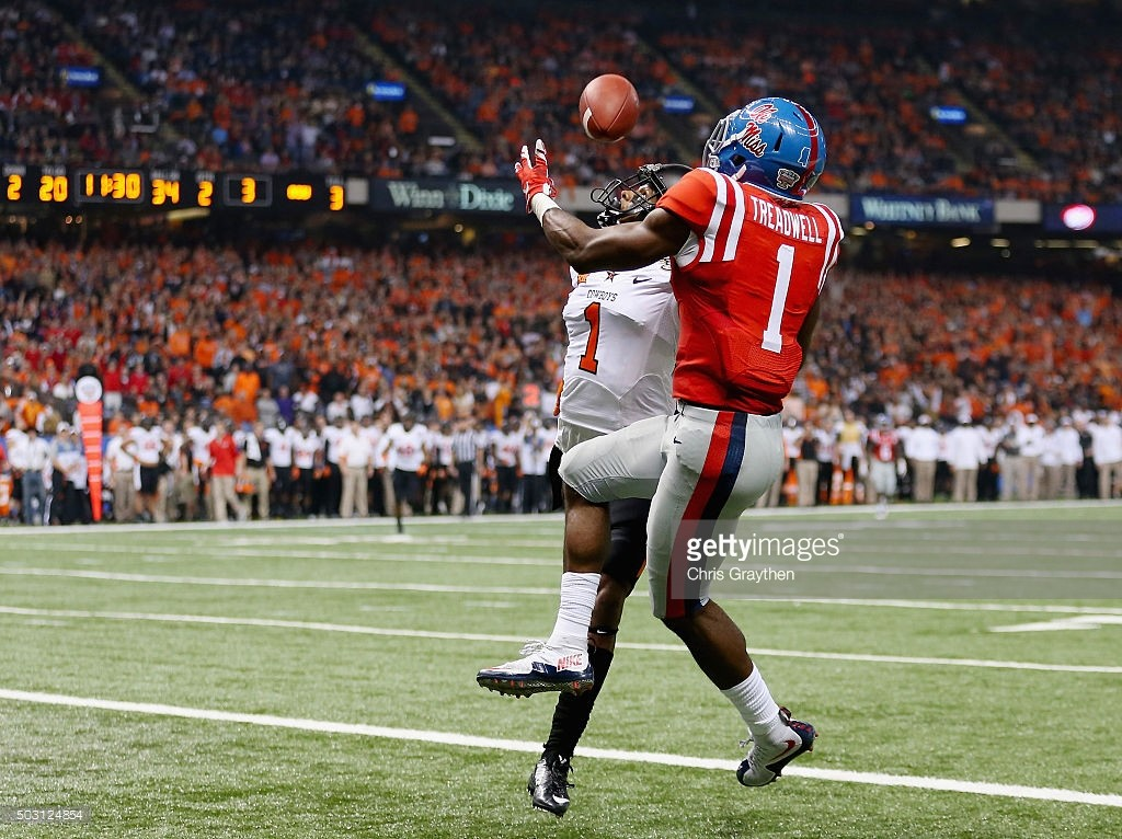 Ole Miss WR Laquon Treadwell reaches out to make a catch overtop of a DB in the endzone.