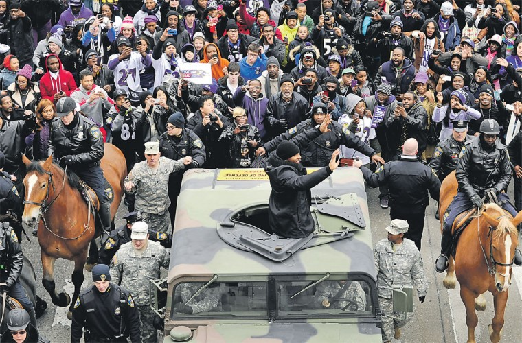 Ray Lewis at the Super Bowl XLVII parade in the middle of a crowd of Ravens fans.
