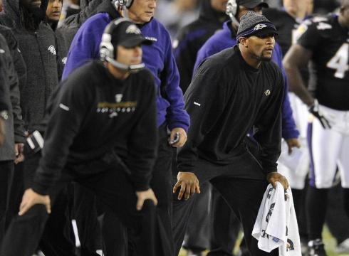 Ray Lewis on the sideline in street clothes during his injury absence.