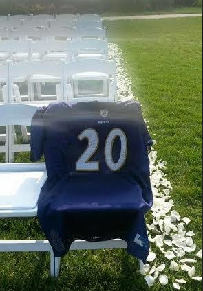 An Ed Reed Ravens jersey draped over a chair at a wedding.
