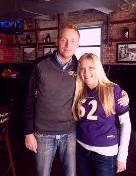 Ryan Jones stands with his arm around his sister, who is in a Ray Lewis jersey.
