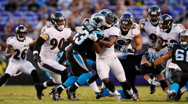 Ravens swarm Panthers RB for a tackle for loss.