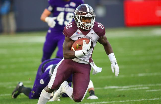 Chase Edmonds of Fordham runs with the football.
