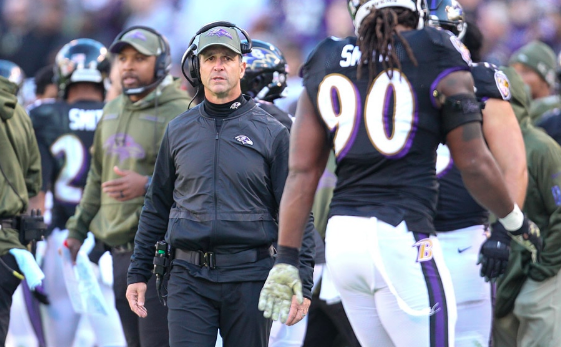 John harbaugh looks at Za'Darius Smith from the sidelines.