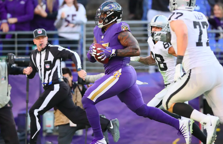 Terrell Suggs runs with the ball against Oakland.