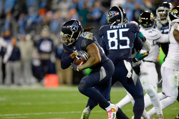 Derrick Henry of the Titans runs against the Jaguars.
