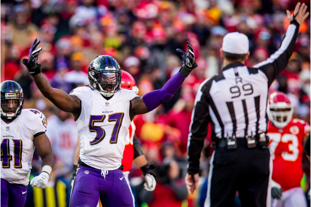C.J. Mosley raises his arms at the referee.