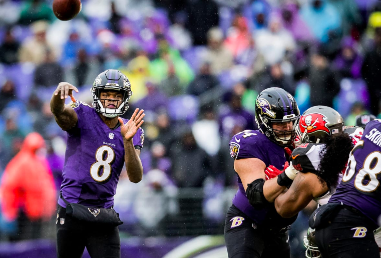 Lamar  Jackson throws as the OL blocks vs. the Bucs.