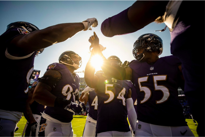 The Ravens defense huddles prior to their playoff game against the Chargers.