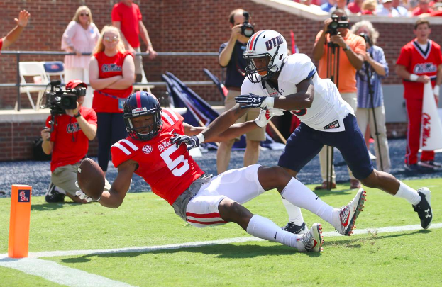 DaMarkus Lodge of Ole Miss brings down a pass in the end zone.