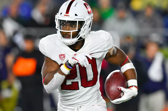 Bryce Love of Stanford carries the football.