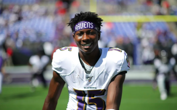 Marquise Brown smiles