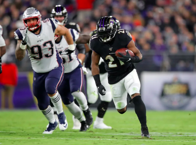 Mark  Ingram runs against the Patriots.