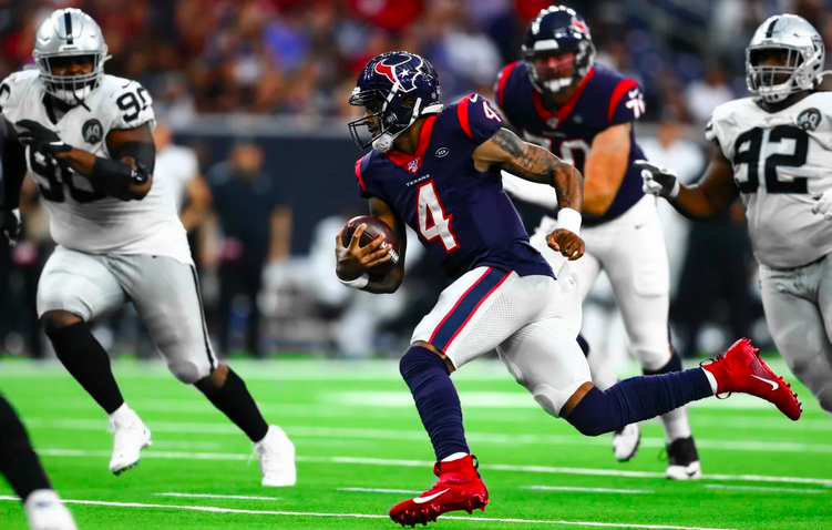 Deshaun Watson runs against Oakland.